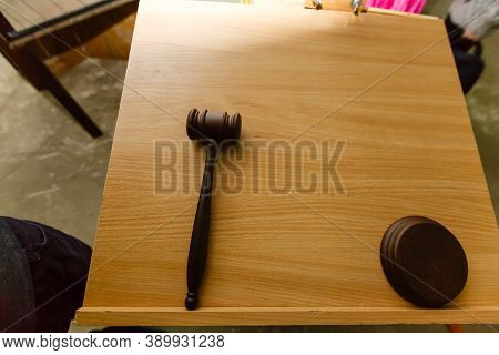 Brown Gavel On Wooden Table. Brown Background. Auction, Celling Art Masterpieces. Gavel For Judge In