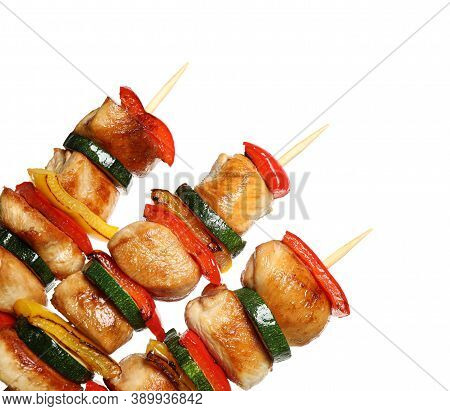 Delicious Chicken Shish Kebabs With Vegetables On White Background