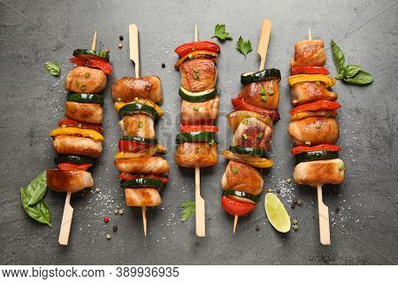 Delicious Chicken Shish Kebabs With Vegetables And Herbs On Grey Table, Flat Lay