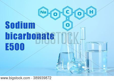 Text Sodium Bicarbonate E500 With Soda Formula And Laboratory Glassware On Background