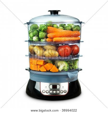 Healthy food in steamer, steam cooker with various vegetables isolated on white