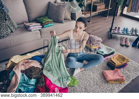 Top Above High Angle View Photo Of Focused Volunteer Girl Sit Floor Carpet Arrange Her Used Clothes