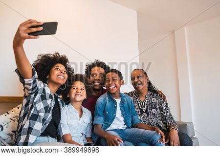 Portrait Of African American Multigenerational Family Taking A Selfie Together With Mobile Phone At