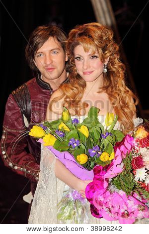 MOSCOW - FEBRUARY 3: Actress Anastasia Makeeva and actor Ilya Viktorov smile after musical