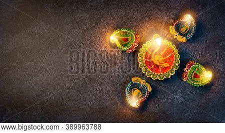 Top View Overhead Clay Lit Light A Fire Already On Diya Or Oil Lamp, Studio Shot On Concrete Backgro