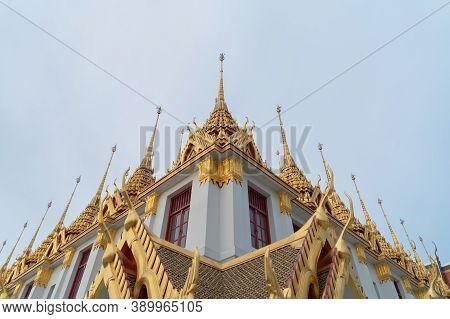 Loha Prasat Wat Ratchanatda Pagoda, A Buddhist Temple Or Wat Saket Buildings With Blue Sky In Bangko