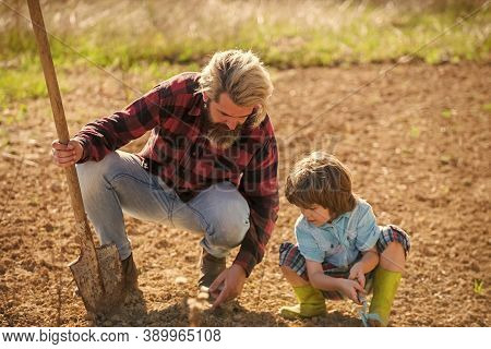 Farming Agriculture. Bearded Man Teach Child Farming. Hobby Farming Activity. Farming And Gardening.