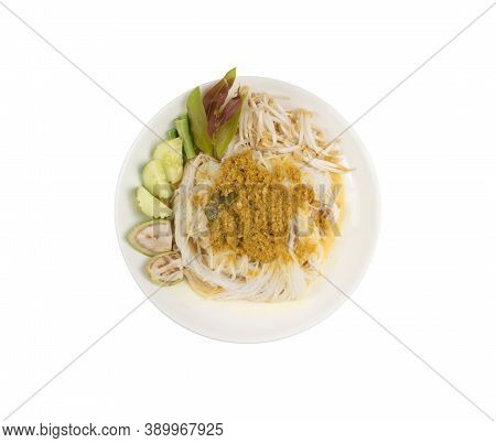 Rice Noodles In Fish Curry Sauce With Vegetables In White Plate On White Background