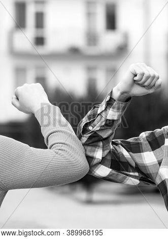 Closeup Elbow Bump. Two People Bump Elbows To Avoid Coronavirus Outdoors. Coronavirus Epidemic. Elbo