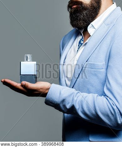 Perfume Or Cologne Bottle, Perfumery, Cosmetics, Scent Cologne Bottle, Male Holding Cologne. Masculi
