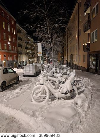Sweden, Stockholm - February 03 2019: The View Of Bikes Rack In The Snow At The Roadside On February