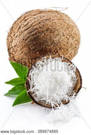 Coconut fruit and shredded coconut flesh isolated on white background.