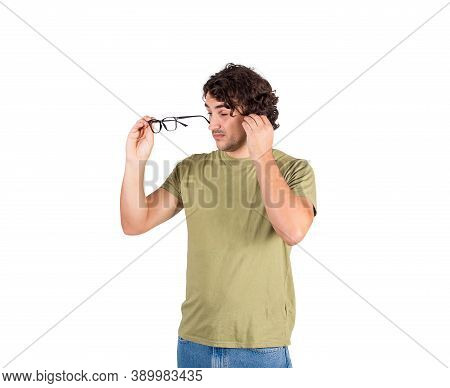 Confused Young Man Fixing Glasses, Trying To Look Through Lenses, Poor Sight Farsightedness, Myopia.