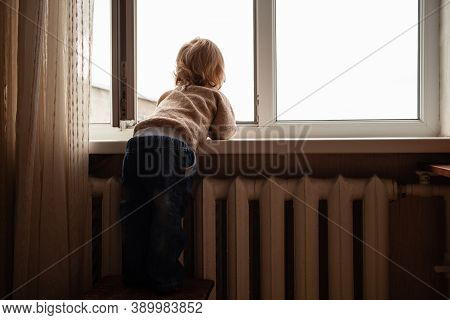The Child Climbs To The Window, The Girl On The Window Sill Rests On The Net, The Danger Of Falling.