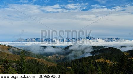 High Tatras Above Clouds With Forested Hills In The Foreground, Tatras, Tatry, Slovakia.