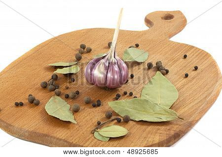 Garlic With The Bay Leaf And Pepper