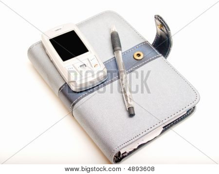 Office Objects - Pen Diary And A Cell Phone
