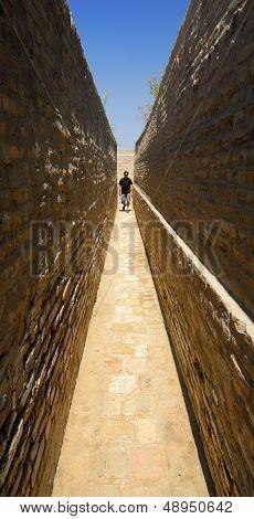 Person in narrow corridor