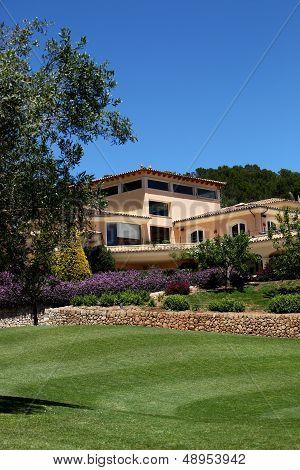 Manicured Lawns Below A Clubhouse