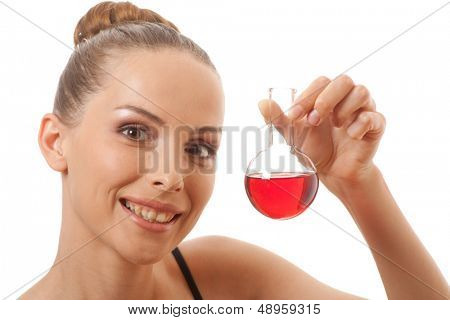 woman holds flask with red liquid, isolated on white background