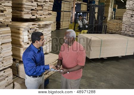 Men stock-taking in warehouse