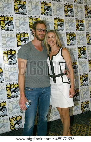 SAN DIEGO, CA - JULY 20: Kris Holden-Ried and Zoie Palmer arrives at the 2013 Comic Con press room at the Hilton San Diego Bayfront hotel on July 20, 2013 in San Diego, CA.