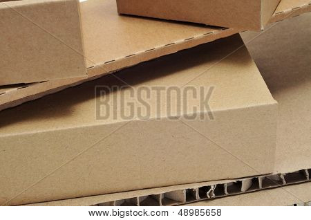 closeup of some brown cardboard boxes and some pieces of corrugated cardboard