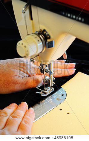 Using a domestic sewing machine.