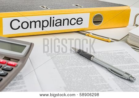 A yellow folder with the label Compliance