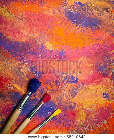 Paintbrushes on abstract grange background poster