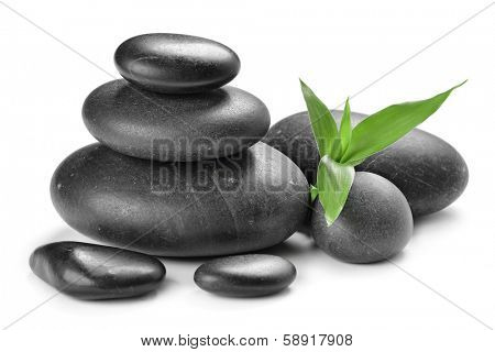 zen stones and bamboo leaf on the white background