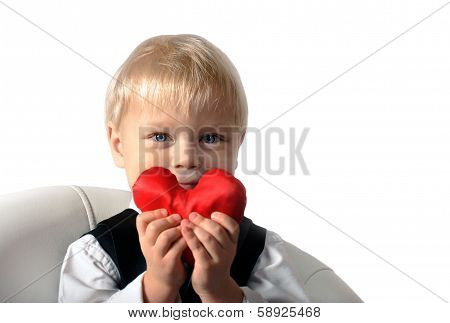Little boy with red Heart in hands.
