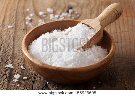 sea salt in wooden bowl and scoop