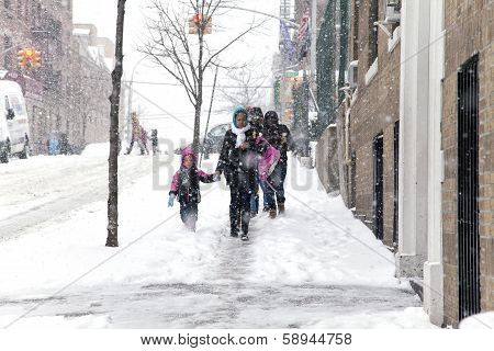 Mother And Child During Snow Storm In New York