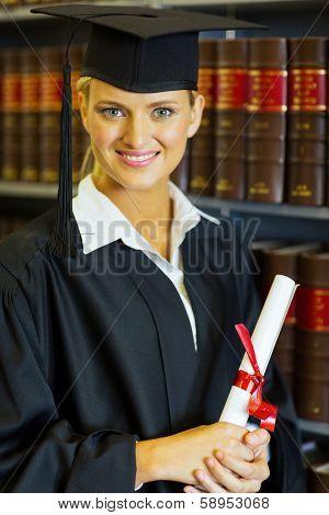 happy female law school graduate in university library