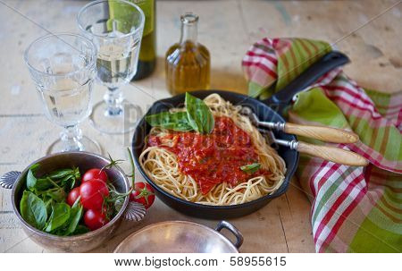 A Bowl Of Spaghetti In Tomato Paste, Cheese And Wine