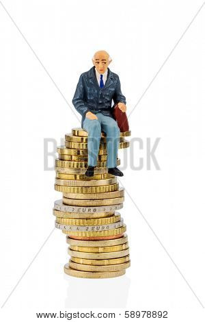 pensioners sitting on a pile of money, symbolic photo for pension, retirement, old-age security