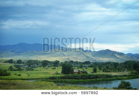 Scene of a river near mountains