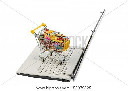 tablets with shopping cart and computer. symbolic photo for the purchase of medicines on the internet