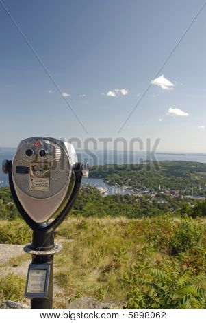 Coin operated telescope looking out across Penobscot Bay in Maine. (vertical) poster