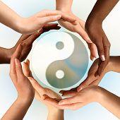 Conceptual yin-yang symbol with multiracial hands surrounding it. Balance, peace, meditation, spirituality concept. poster