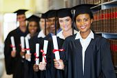 group of happy graduates holding diploma in library poster