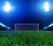 Stadium lights at night and the goal poster