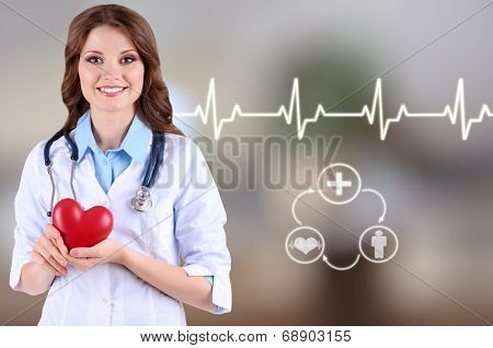 Young beautiful doctor on hospital background