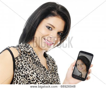Closeup of a happy teen girl showing her phone to the viewer with her self-ie image.  On a white background.