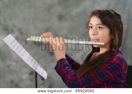 Young girl plays flute