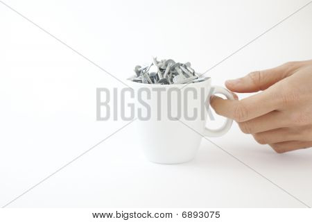 Woman Picks Up Coffee Cup Of Nails
