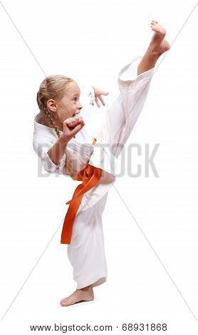 Circular blow leg is doing sportwoman in karategi