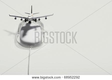 Jumbo jet on apple macintosh computer mouse, digital composite