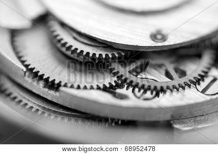 Black White Metallic Background With Metal Cogwheels A Clockwork. Macro